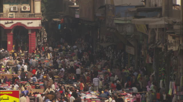 shoppers fill a middle-eastern bazaar. - middle east stock videos & royalty-free footage