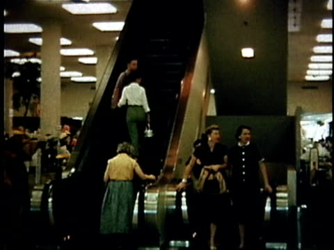 WS Shoppers going up escalator in department store / USA