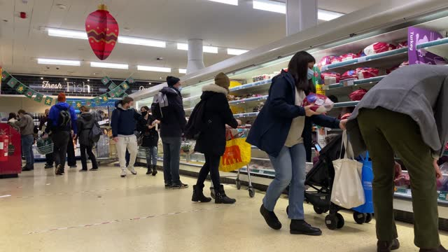 shoppers in a supermarket as they prepare for the festive season on december 23, 2020 in london, united kingdom. a new strain of the covid-19 virus... - groceries stock videos & royalty-free footage