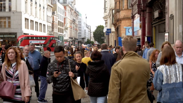 shoppers in london oxford street - high street stock videos & royalty-free footage
