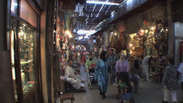 WS Shoppers in souk, Marrakech, Morocco