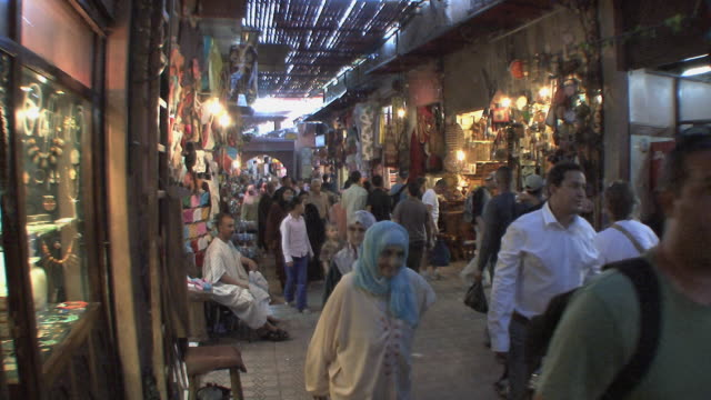 ws shoppers in souk, marrakech, morocco - souk stock videos & royalty-free footage