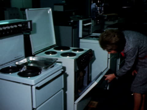 Shoppers inspect cookers in an electrical shop