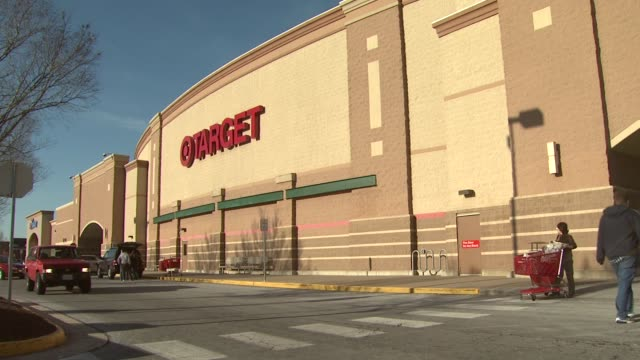 Shoppers leave and arrive at Target Store on sunny day
