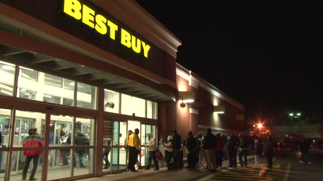 Shoppers line up at BEST BUY Thanksgiving Day eve in anticipation of the store opening at midnight to officially start Black Friday Sale / Midnight...