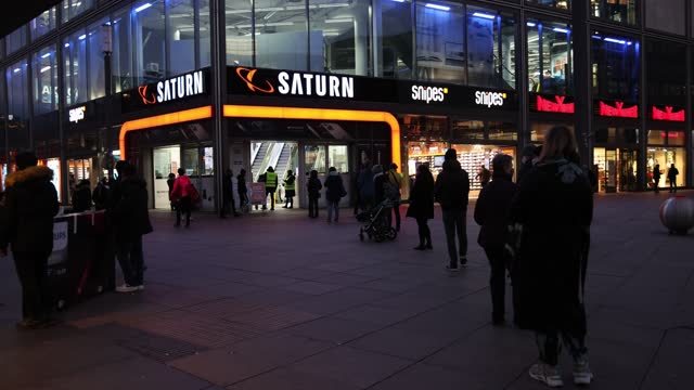 shoppers line up to enter a saturn, a popular home electronics store, advertising pre-christmas sales at alexanderplatz on cyber monday during the... - electronics store stock videos & royalty-free footage