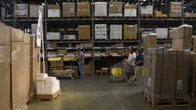 Shoppers load merchandise on a cart inside an Ikea store in Emeryville California US on Tuesday Aug 9 2016 Shots wide shot of aisle in store...