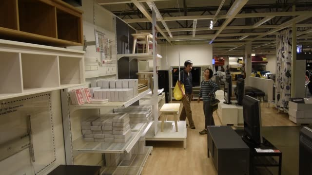 shoppers load merchandise on a cart inside an ikea store in emeryville, california, u.s., on tuesday, aug 9, 2016 shots: wide shot of merchandise... - emeryville stock videos & royalty-free footage