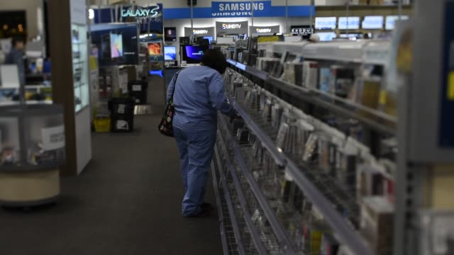 shoppers look at products on display at an intel display inside a best buy co store in san francisco, california, us, on friday, may 15, 2015 shots:... - dvd stock videos & royalty-free footage