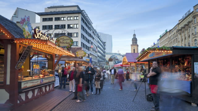 shoppers move through a christmas market at golden hour. - hesse germany stock videos and b-roll footage
