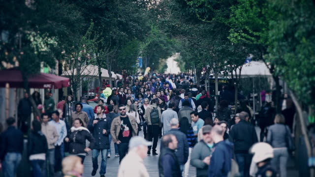 shoppers on calle de la montera, madrid - pedestrian zone stock videos & royalty-free footage
