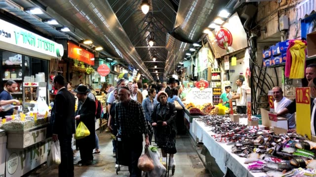 shoppers pack the mahane yehuda shuk on a weekday evening. - weekday stock videos & royalty-free footage