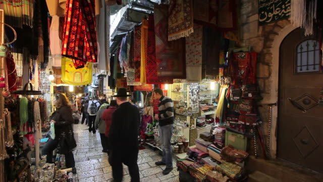 shoppers pass booths located in the suq el-bazaar. - jerusalem stock-videos und b-roll-filmmaterial