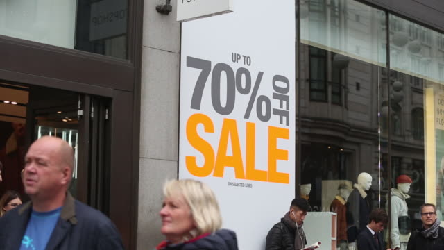 Shoppers passing a sale sign on Oxford Street on October 19 2016 in London England Inflation rose to 10% in September up from 06% in August according...