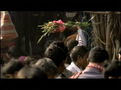 shoppers peruse goods at a market in kolkata. - kolkata stock videos & royalty-free footage