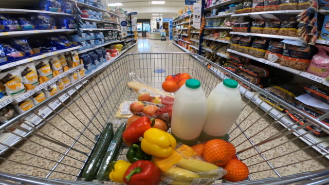 shoppers point of view moving through supermarket aisle. - food stock videos & royalty-free footage