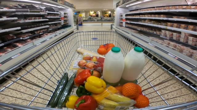 shoppers point of view moving through supermarket aisle. - groceries stock videos & royalty-free footage