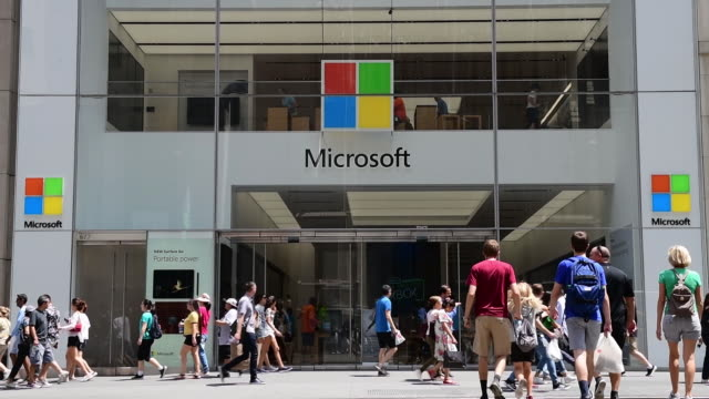 shoppers product and branding at the microsoft fifth avenue flagship store in manhattan new york city new york us on saturday july 14 2018 - yellow taxi stock videos & royalty-free footage