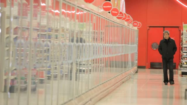 shoppers push shopping carts while browsing goods inside a target store in seattle washington on may 15th 2015 shots shoppers push their cart onto a... - push cart stock videos and b-roll footage
