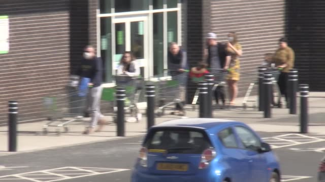 shoppers queue at varying distances to get into supermarkets in the west midlands with social distancing measures in place because of the coronavirus... - distant stock videos & royalty-free footage