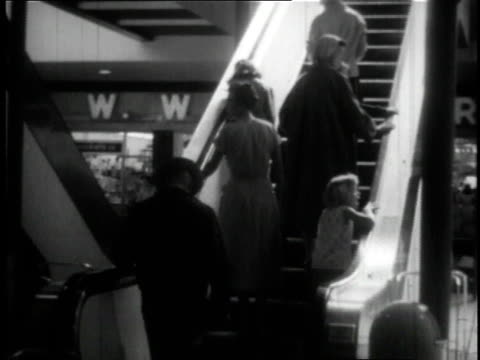 1950 MONTAGE shoppers roaming around mall in Minneapolis / Minnesota, United States