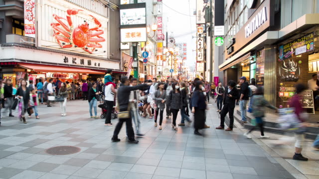 TL, WS Shoppers rush through Osaka centre past giant mechanical crab / Osaka, Japan