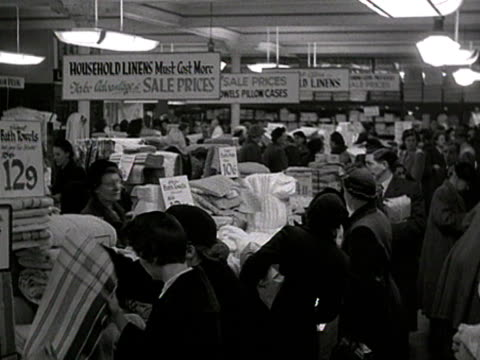 shoppers search for bargains during a department stores winter sale. - department store stock videos & royalty-free footage