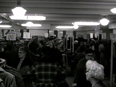 shoppers search for bargains in the coat section of a deparment sale during its winter sale. - department store stock videos & royalty-free footage