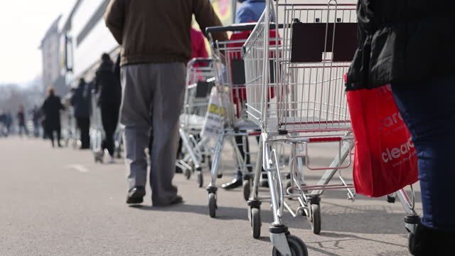 shoppers stand in a queue outside a supermarket - groceries stock videos & royalty-free footage