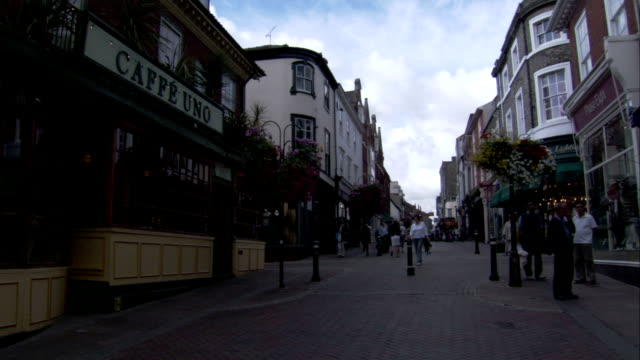 shoppers stroll along a pedestrian precinct, bury st edmunds. available in hd. - bury st edmunds stock videos & royalty-free footage