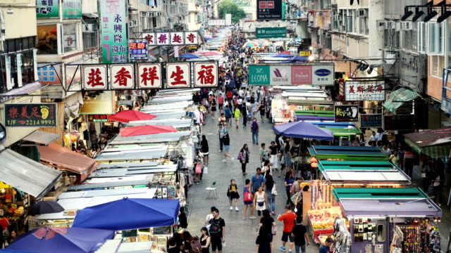shoppers stroll along mong kok market - mong kok stock videos & royalty-free footage