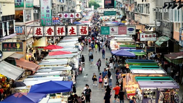 shoppers stroll along mong kok market - hong kong stock videos & royalty-free footage