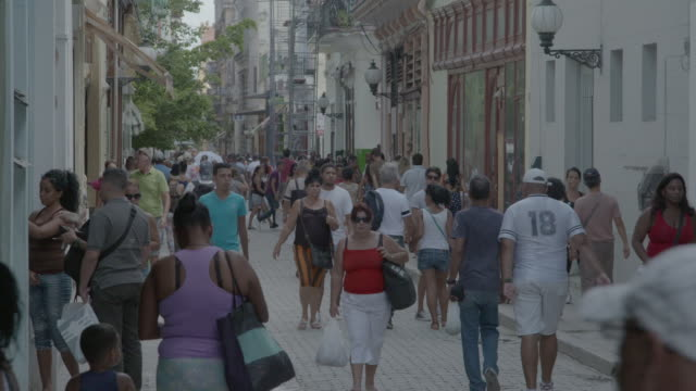 Shoppers stroll on calle obispo in Havana