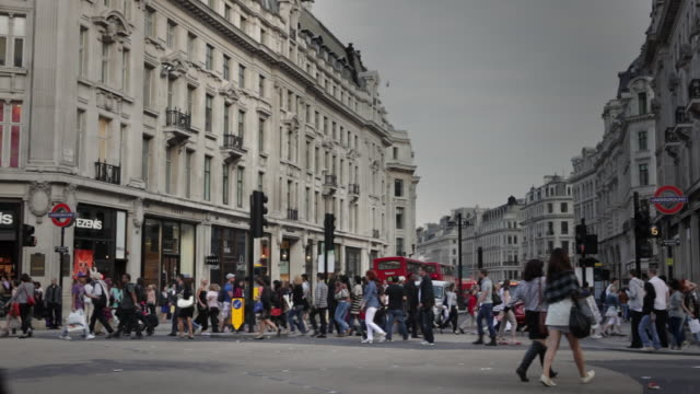 shoppers stroll through oxford circus in london. - oxford circus stock videos and b-roll footage