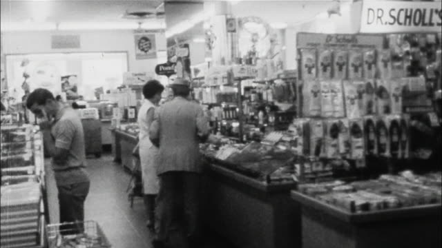 vídeos de stock, filmes e b-roll de shoppers stroll through the aisles of woolworth's in new york city. - woolworths