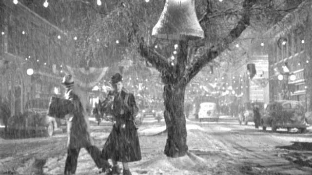 shoppers struggle through heavy snow and traffic on a main street decorated for christmas. - 1946 stock videos & royalty-free footage