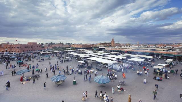 Shoppers visit  the Djemaa el-Fna souk in  Marrakesh.