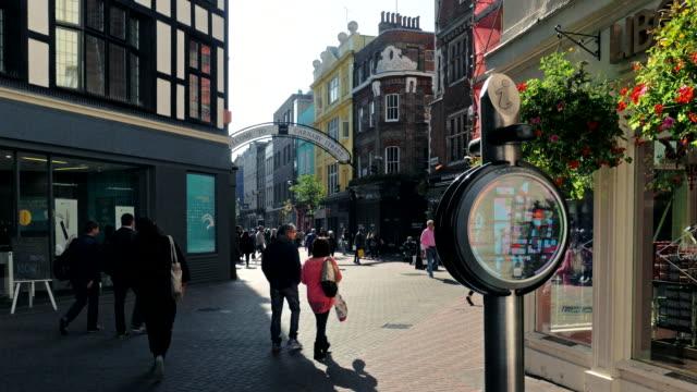 Shoppers walk along Carnaby Street, London, UK