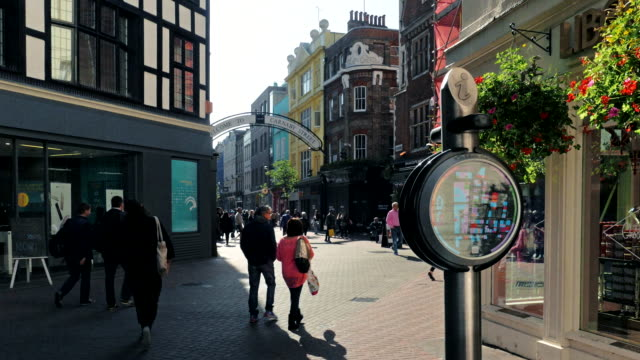 shoppers walk along carnaby street, london, uk - establishing shot stock videos & royalty-free footage