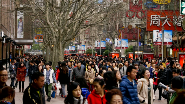 shoppers walk along the east nanjing road in shanghai, china. - east china stock videos & royalty-free footage