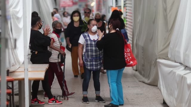 shoppers walk around wearing face masks at martínez de la torre market on may 18, 2020 in mexico city, mexico. after three weeks of being closed due... - mexico stock videos & royalty-free footage
