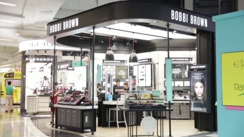 shoppers walk past a bobbi brown store, operated by estee lauder companies inc., in the raffles city shopping mall in shanghai, china, on wednesday,... - raffles city stock videos & royalty-free footage