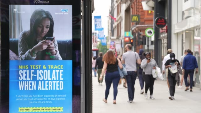 shoppers walk past a test and trace government advert on oxford street following closure due to the coronavirus outbreak on june 15 2020 in london... - shape stock videos & royalty-free footage