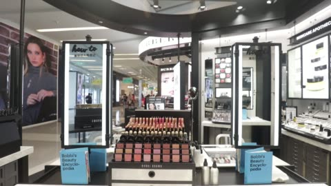 shoppers walk past an estee lauder companies inc. store in the raffles city shopping mall in shanghai, china, on wednesday, may 31 blushers sit on... - raffles city stock videos & royalty-free footage