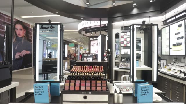 shoppers walk past an estee lauder companies inc store in the raffles city shopping mall in shanghai china on wednesday may 31 blushers sit on... - blusher make up stock videos & royalty-free footage