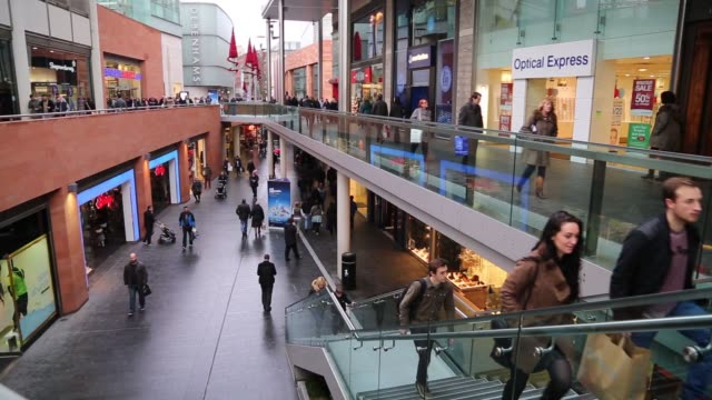 shoppers walk the high streets and shopping complexes in liverpool, united kingdom on wednesday, december 17, 2014 - advertisement stock videos & royalty-free footage