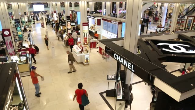 Shoppers walk though a Macy's Inc department store in New York US on Monday August 10 2015 Shots Interior shots look down at shoppers on the ground...