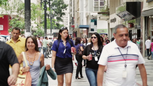 MS Shoppers walk through a busy street in downtown Sao Paulo / Sao Paulo, Brazil