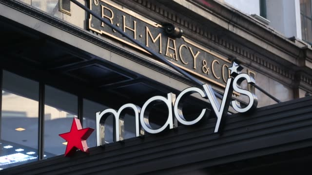 Shoppers walk through a Macys Inc department store in New York US on Monday Feb 22 2016 Macys Inc the largest US department store company is...