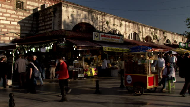 shoppers walk through a market in turkey. available in hd - modest clothing stock videos & royalty-free footage